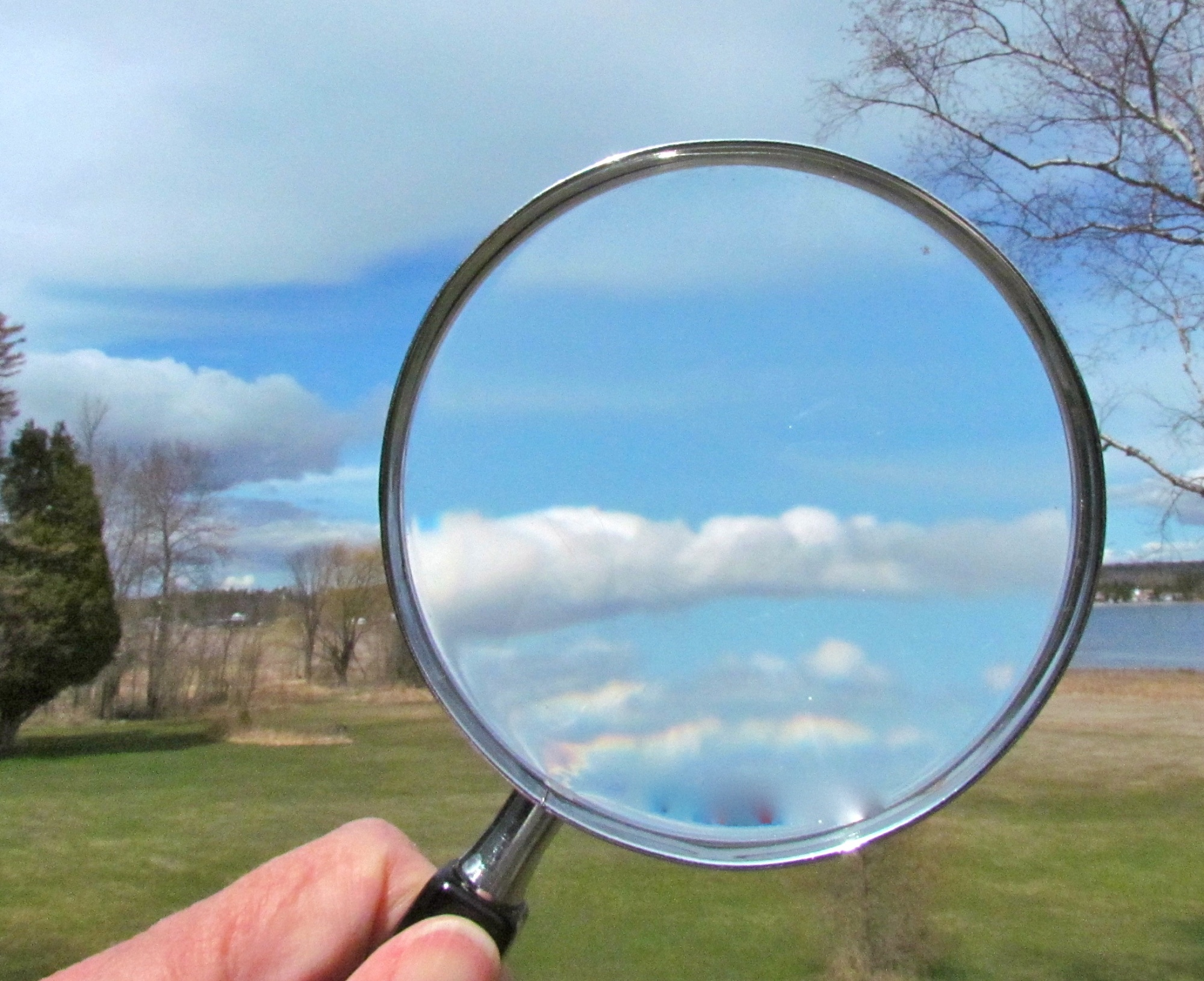 magnifying glass looking at clouds